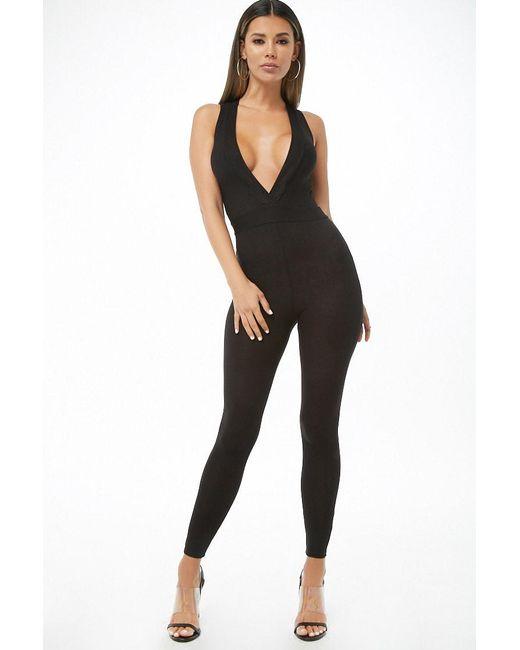 fcff84ec465 Forever 21 - Black Women s Ribbed Surplice Jumpsuit - Lyst ...