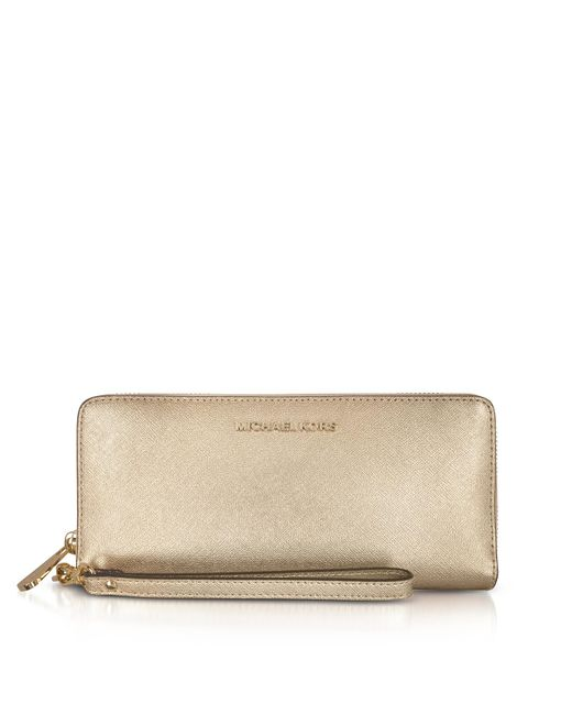 Michael Kors - Jet Set Travel Large Pale Gold Metallic Leather Continental Wallet - Lyst