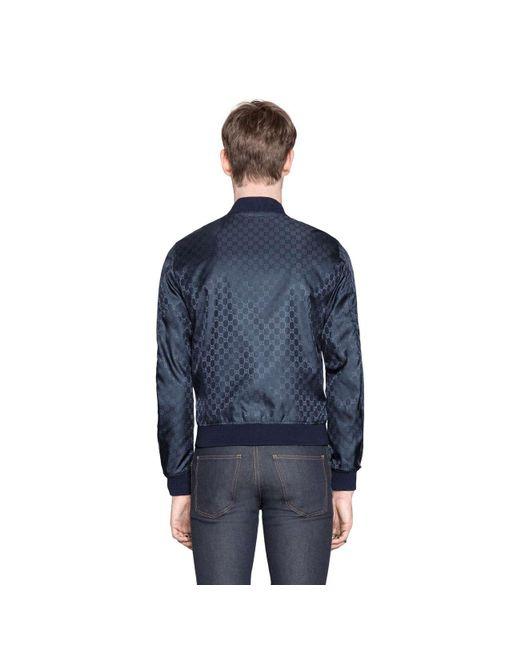 fbc57967eb33 ... Gucci - Blue Reversible GG Jacquard Nylon Bomber Jacket for Men - Lyst  ...