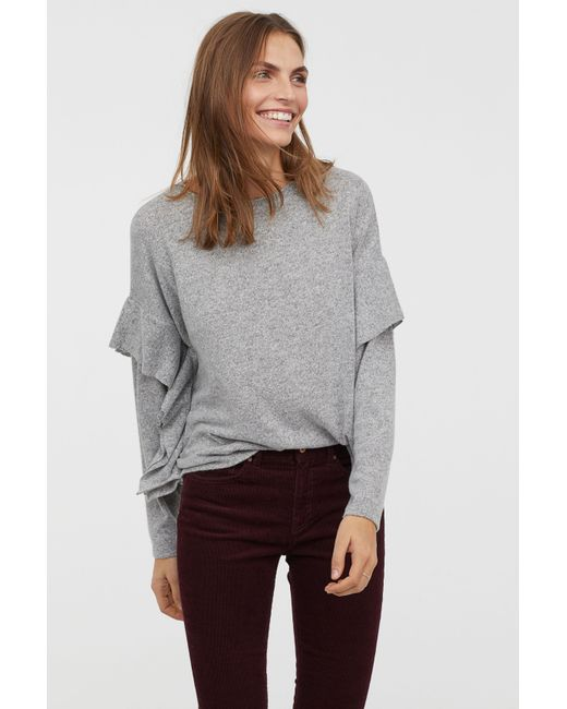e5c68dbfd22e9 H M - Gray Top With Flounces - Lyst ...