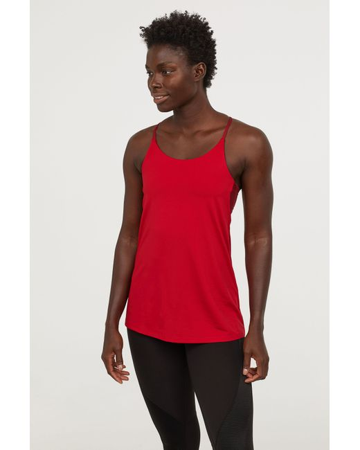 30aefec881 H M - Red Sports Tank Top With Bra - Lyst ...