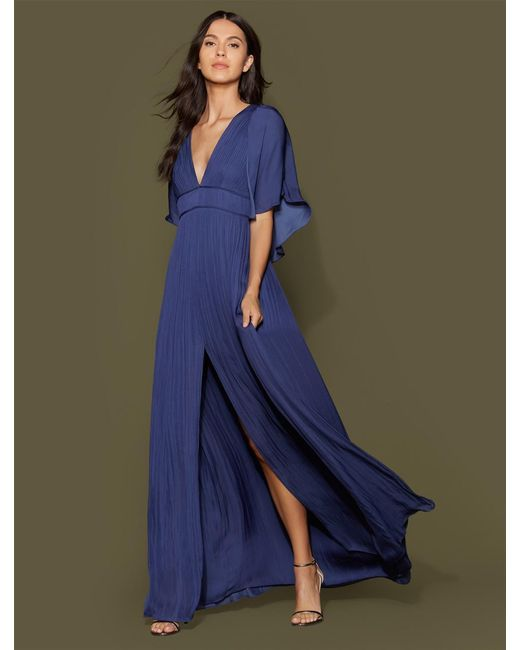 fc70f346501 Halston Heritage - Blue Cape Sleeve Flowy Pleated Gown - Lyst