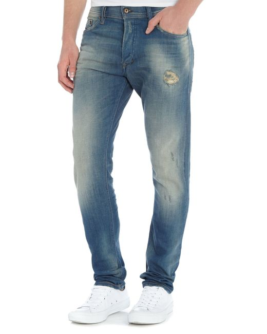 Carrot Fit Green Cast Destroyed Jean in Blue for Men Denim Light Wash