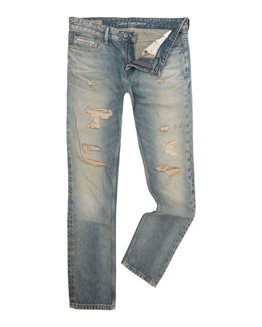 calvin klein destructed slim straight fit jeans in blue. Black Bedroom Furniture Sets. Home Design Ideas