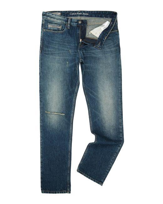 calvin klein slim straight scarred blue jeans in blue. Black Bedroom Furniture Sets. Home Design Ideas