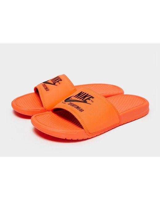 1569441f1 ... Nike - Orange Sportswear Benassi Text Slides for Men - Lyst ...