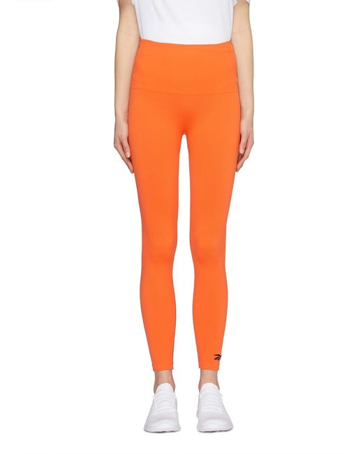 Victoria Beckham - Orange X Reebok Logo Embroidered Performance leggings -  Lyst ... 2a1d13ec7d0d