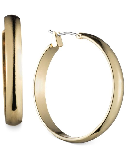 """Anne Klein - Metallic Gold-tone 1 1/4""""wide Hoop Earrings - Lyst"""