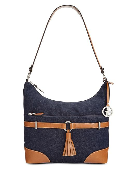 Hello, hobo. A pop of colorful leather highlights the shoulder-right shape of this Dooney & Bourke favorite featuring a divided interior and signature monogram.