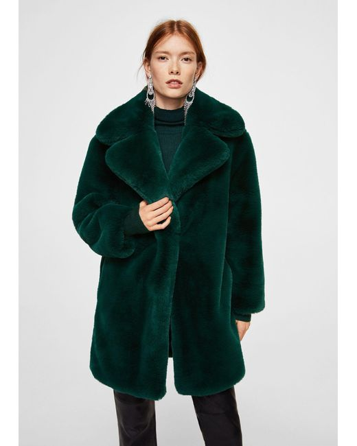 Green coat with white fur