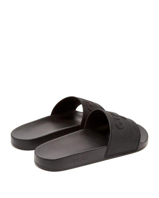 555450610e2 ... Gucci - Black Logo Embossed Rubber Slides for Men - Lyst ...