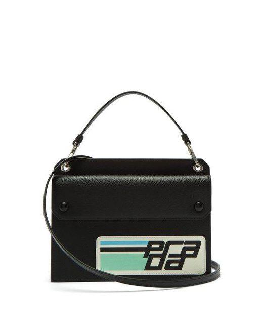 90ada4ba06e721 ... wholesale prada black logo patch saffiano leather cross body bag lyst  d05cd 4111b