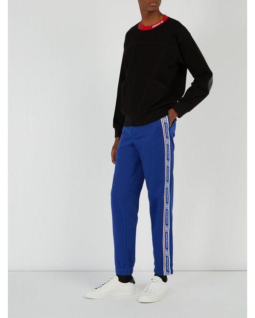 ce9f74c7d65 ... Givenchy - Blue Pantalon de jogging à bandes latérales logo for Men -  Lyst ...
