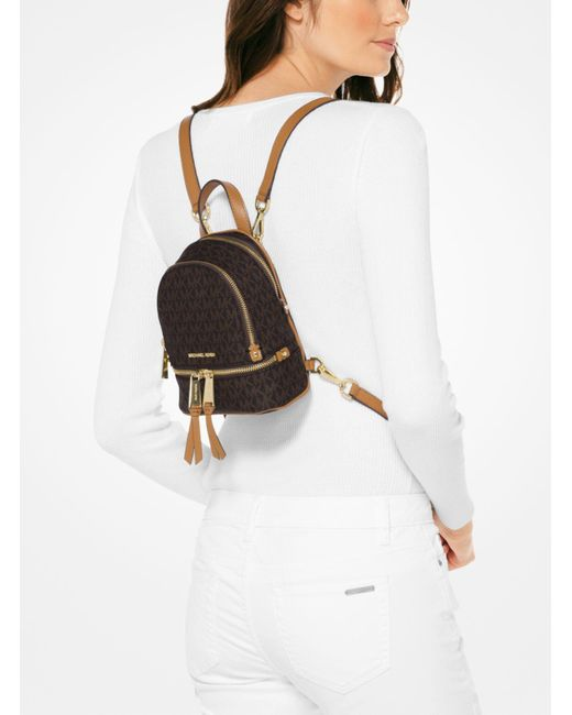 ... Michael Kors - Brown Rhea Mini Logo Backpack - Lyst ... 5b36c32784