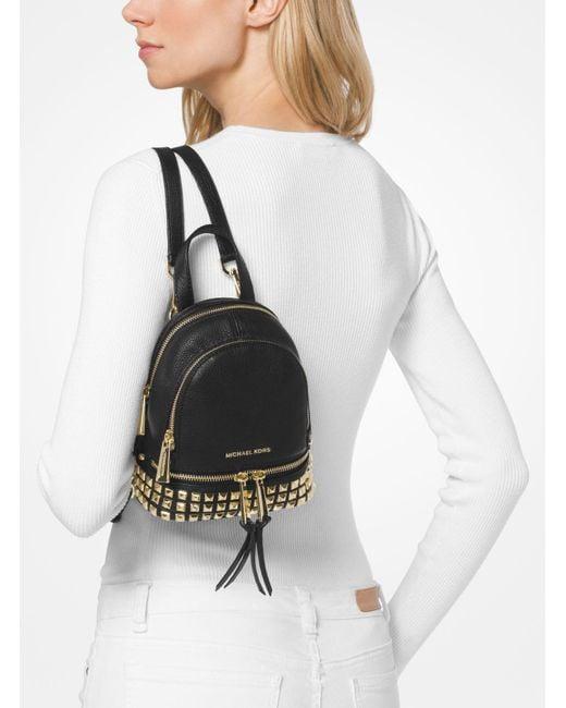886ea492a9e2 ... MICHAEL Michael Kors - Black Rhea Mini Studded Leather Backpack - Lyst  ...
