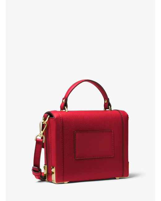 01e42327446f ... MICHAEL Michael Kors - Red Jayne Small Pebbled Leather Trunk Bag - Lyst  ...