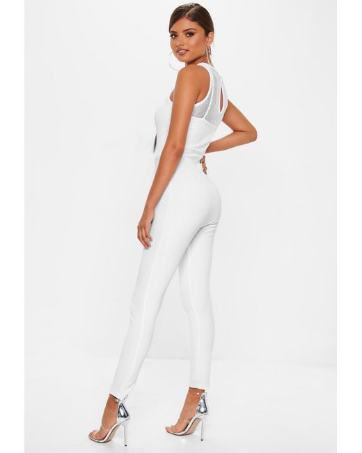 4e45337923 ... Missguided - White Fishnet Top Jumpsuit - Lyst ...