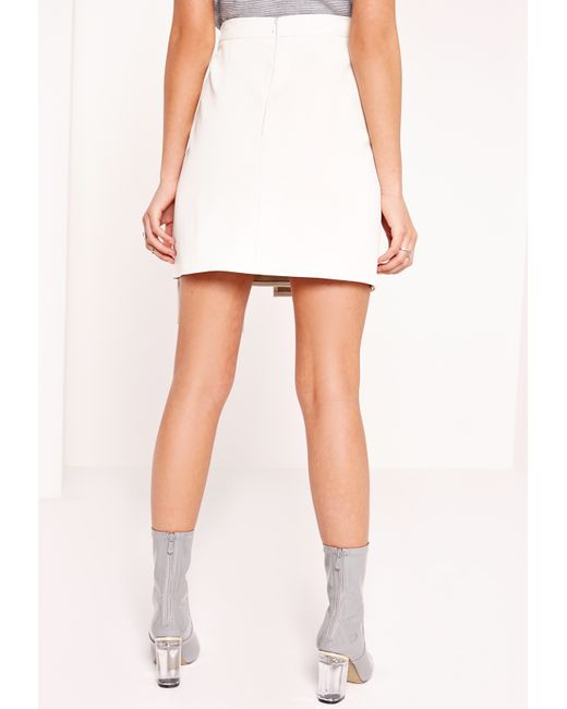 missguided wrap front faux leather mini skirt white in