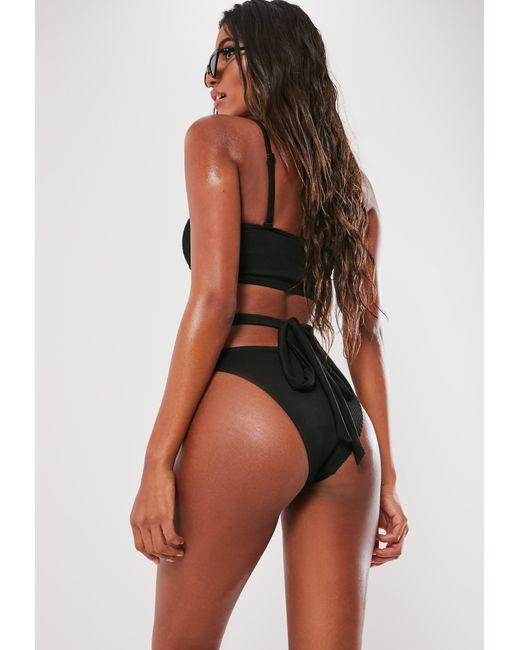36b69d20c4985 ... Missguided - Black Rib Strappy Bandeau Bikini Top - Lyst ...