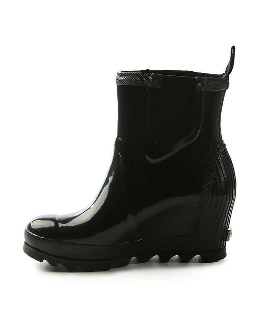 38f24e3eef8 ... Sorel - Black Joan Rain Wedge Chelsea Gloss Boot - Lyst ...
