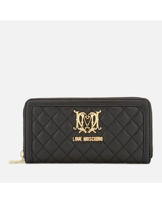 Love Moschino - Black Quilted Zip Around Purse - Lyst
