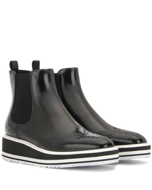prada chelsea patent leather platform ankle boots in black