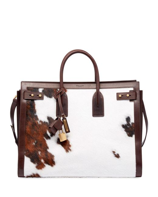 7266a22f8a Lyst - Saint Laurent Men s Ysl Tote Bag In Cow Print in Brown for Men