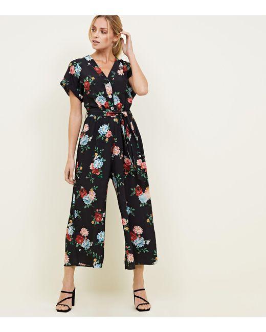 cdec6d871c0 New Look Black Bright Floral Print Crop Jumpsuit in Black - Lyst