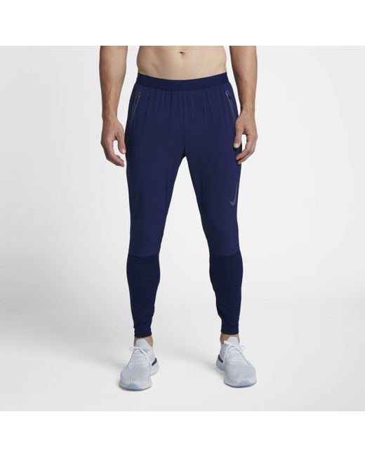 7f21f083d59 Nike Swift Running Trousers in Blue for Men - Lyst