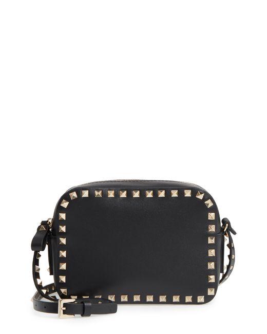 904605a5f185 Lyst - Valentino Rockstud Camera Leather Cross Body Bag in Black ...