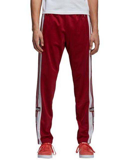 Lyst adidas originali adibreak pantaloni della tuta in rosso per gli uomini.