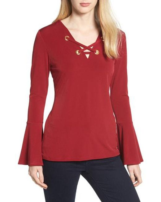 Lyst Michael Michael Kors Bell Sleeve Lace Up Top In Red