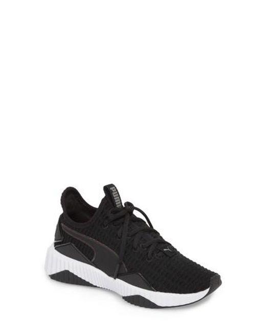 f2cdae99c52757 Lyst - Puma Defy Sneaker in Black