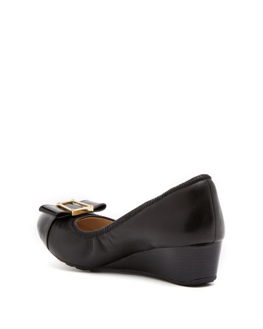 583b6849b8 ... Cole Haan - Black Emory Bow Leather Wedge Pump - Lyst ...