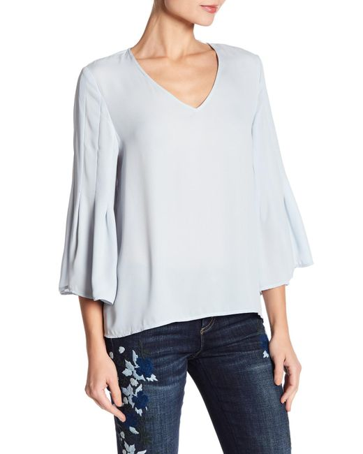 Cece by Cynthia Steffe - Blue Flared Sleeve V-neck Blouse - Lyst