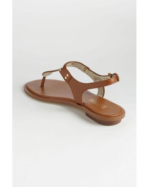 69fa017b0101c ... MICHAEL Michael Kors - Brown Mk Plate Thong (navy Saffiano 1) Women s  Sandals ...
