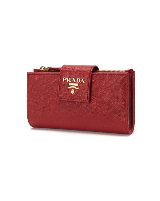 096e10357517f5 ... uk prada red saffiano leather tab wallet lyst 60413 8bc57