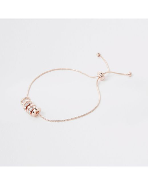 River Island - Metallic Rose Gold Tone Paved Circle Lariat Bracelet - Lyst