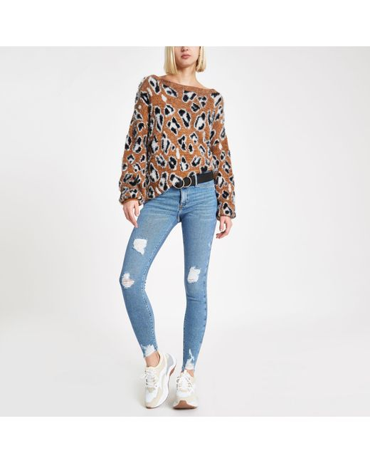 River Island - Mid Blue Ripped Hem Mid Rise Molly jeggings - Lyst