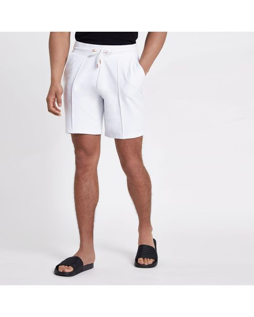 0b67cedd92 River Island - White Pintuck Wasp Embroidered Slim Shorts for Men - Lyst ...