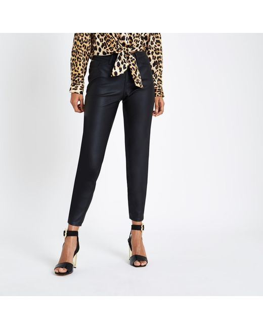 6aba1efff7c3d7 River Island - Black Petite Coated Molly jeggings - Lyst ...