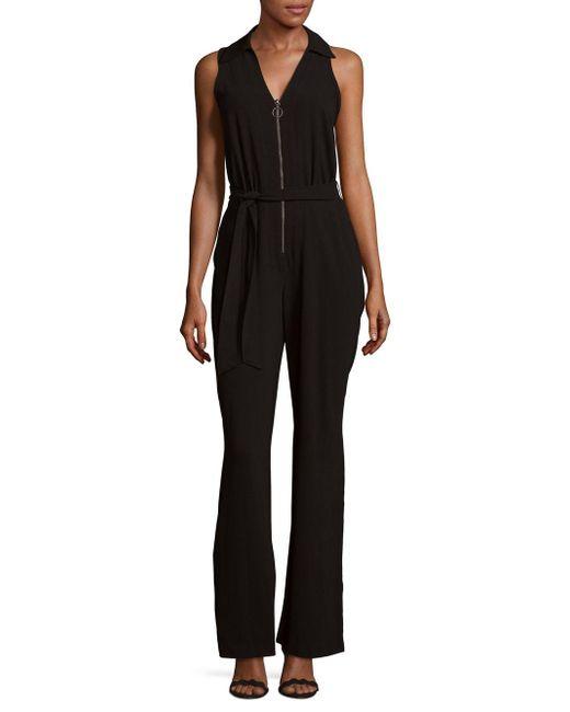 Trina Turk | Black Zip-front Jumpsuit | Lyst