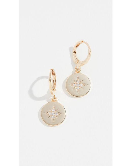 Shashi - Metallic Starburst Coin Huggie Earrings - Lyst
