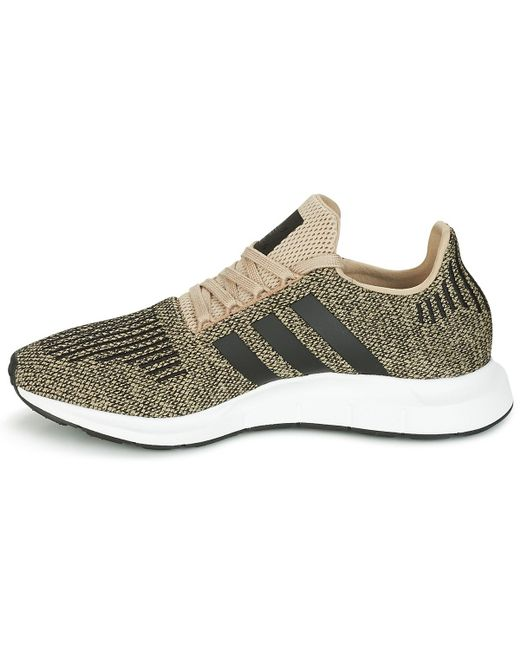 1e1368a5ed4ee ... Lyst Adidas - Metallic Swift Run Women s Shoes (trainers) In Gold ...