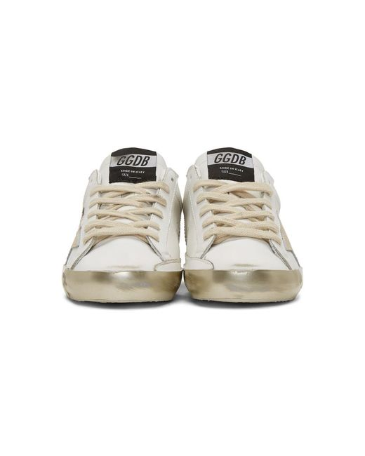 349a931c95a ... Golden Goose Deluxe Brand - White And Gold Superstar Sneakers - Lyst ...