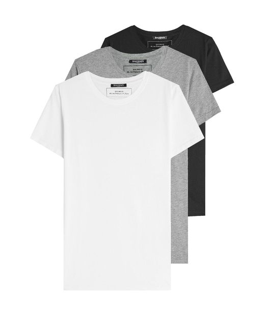 Men's Balmain T-shirts You can't miss out on Balmain's T-shirts - no laid-back look is complete without one. With classic tailoring and bold, graphic-prints to match, .
