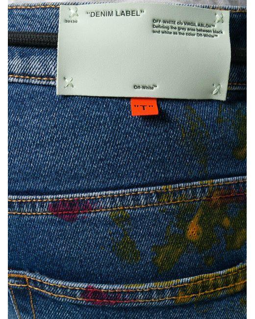 3385f0156dd ... Off-White c o Virgil Abloh - Blue Paint Splattered Skinny Jeans for Men