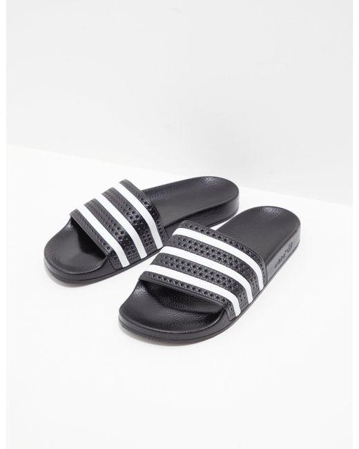 1df9f6d7a717 Lyst - adidas Originals Adilette Slides Black in Black for Men