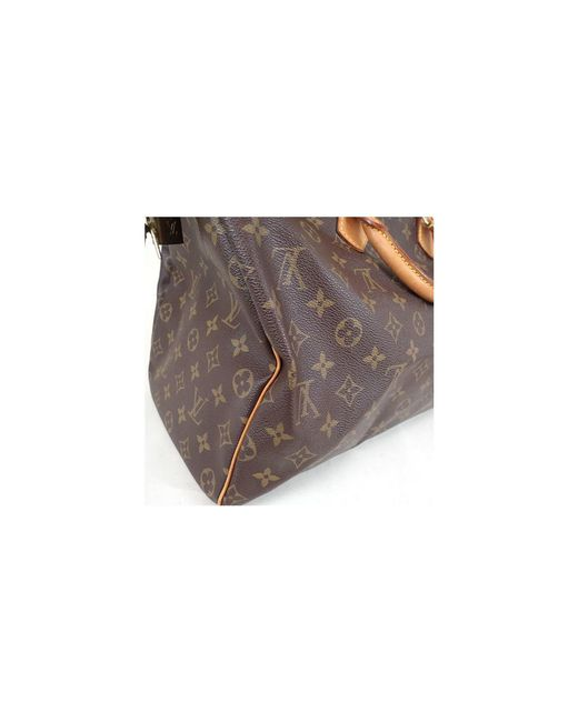 fef4981c11cb ... Louis Vuitton - Brown Monogram Canvas Speedy 40 Bag - Lyst