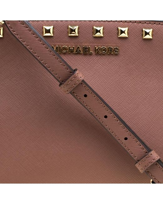 942229fa5d02 ... MICHAEL Michael Kors - Natural Dark Medium Studded Selma Crossbody Bag  - Lyst ...